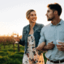 Couple drinking wine in a vineyard