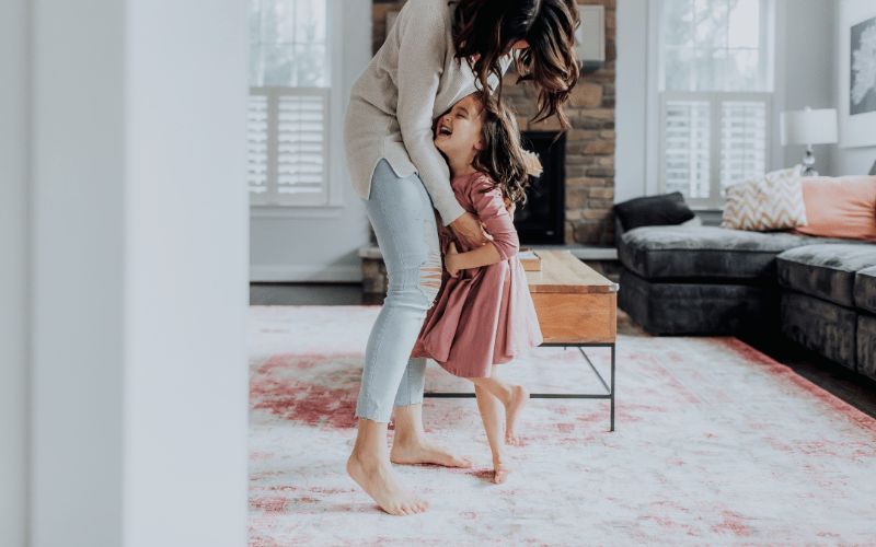 Woman dancing with child