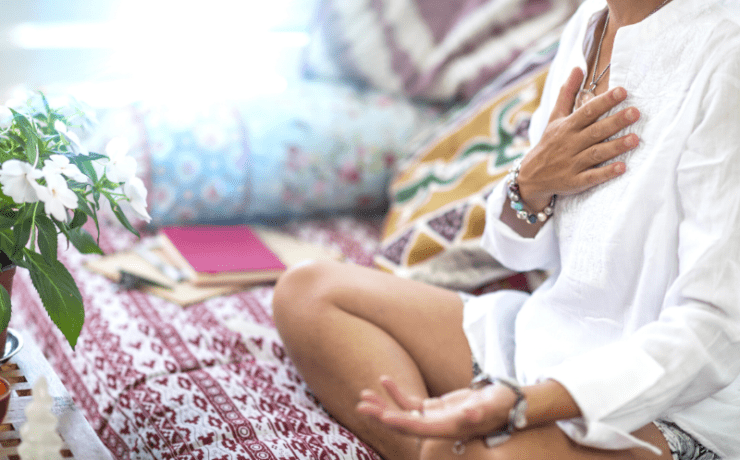 Woman meditating open to change