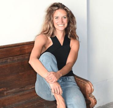 Katie Jones on a wooden bench